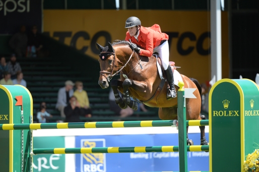 Ben Asselin of CAN riding Veyron during the RBC Grand Prix event at the Spruce Meadows National.