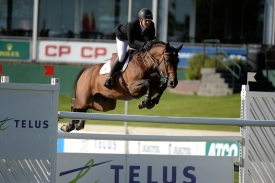 Ben Asselin of CAN riding Veyron during the Telus Cup at 2016 Spruce Meadows Masters. (Mike Sturk photo)