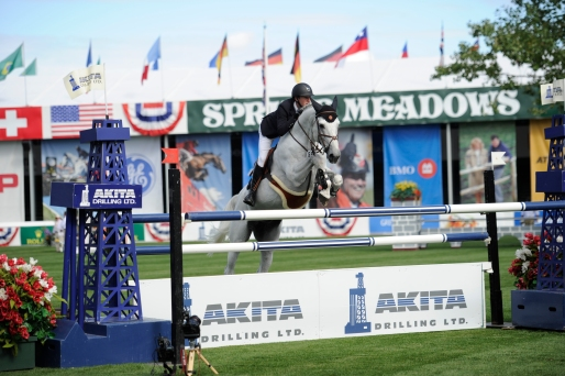Ben Asselin of CAN riding Doremi during the Akita Drilling Cup at the Spruce Meadows Masters.